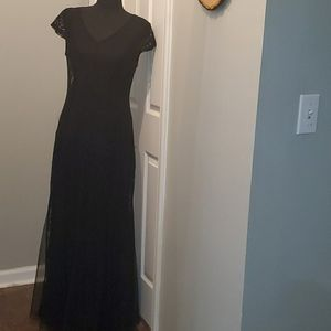 Black lacy long fit and flare dress.